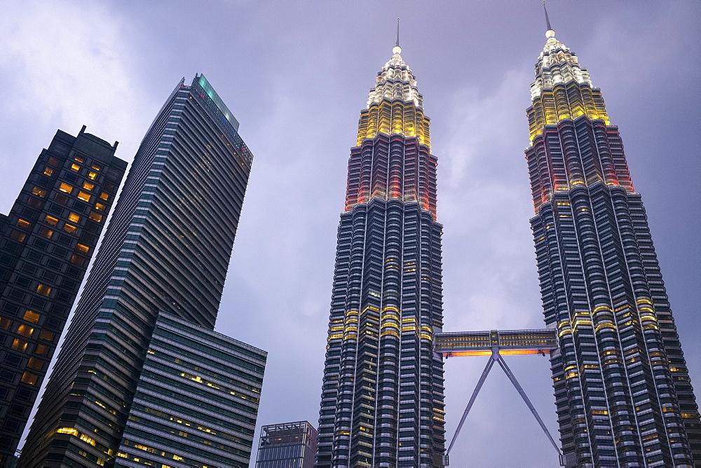 Kuala Lumpur skyline with the Petronas Twin Towers, designed by Cesar Pelli, illuminated at dusk, Kuala Lumpur, Malaysia, Southeast Asia, Asia - 785-2428