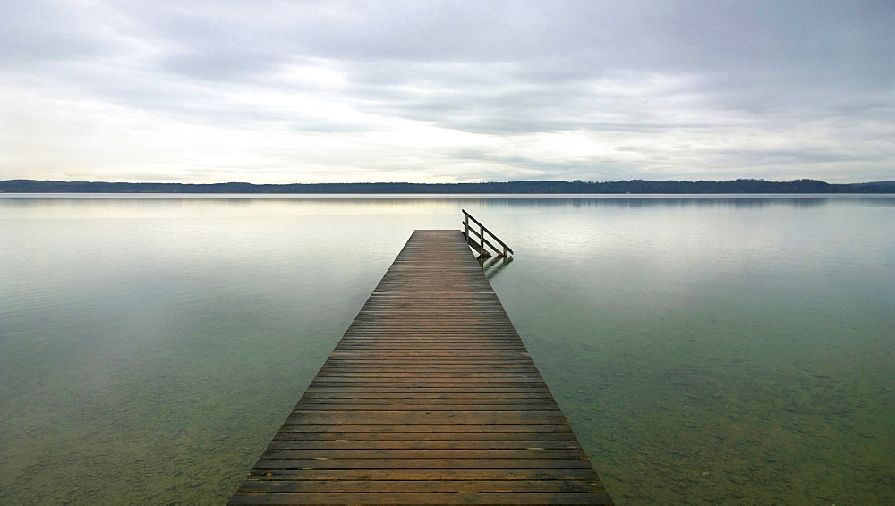 Wooden Jetty Leading Out On Lake Starnberg In Germany