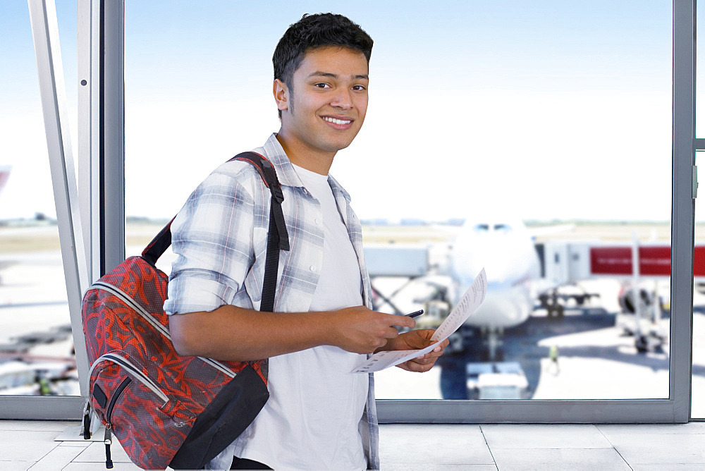 Teenager Going Travelling In Airport Departure Lounge