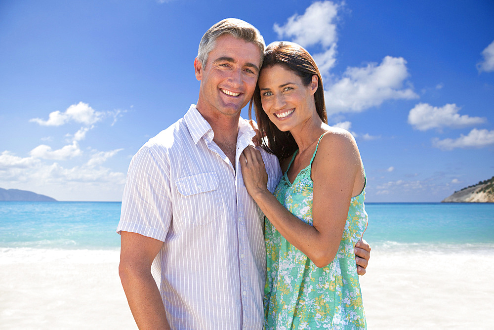 Mature Couple Enjoying Mediterranean Beach Vacation