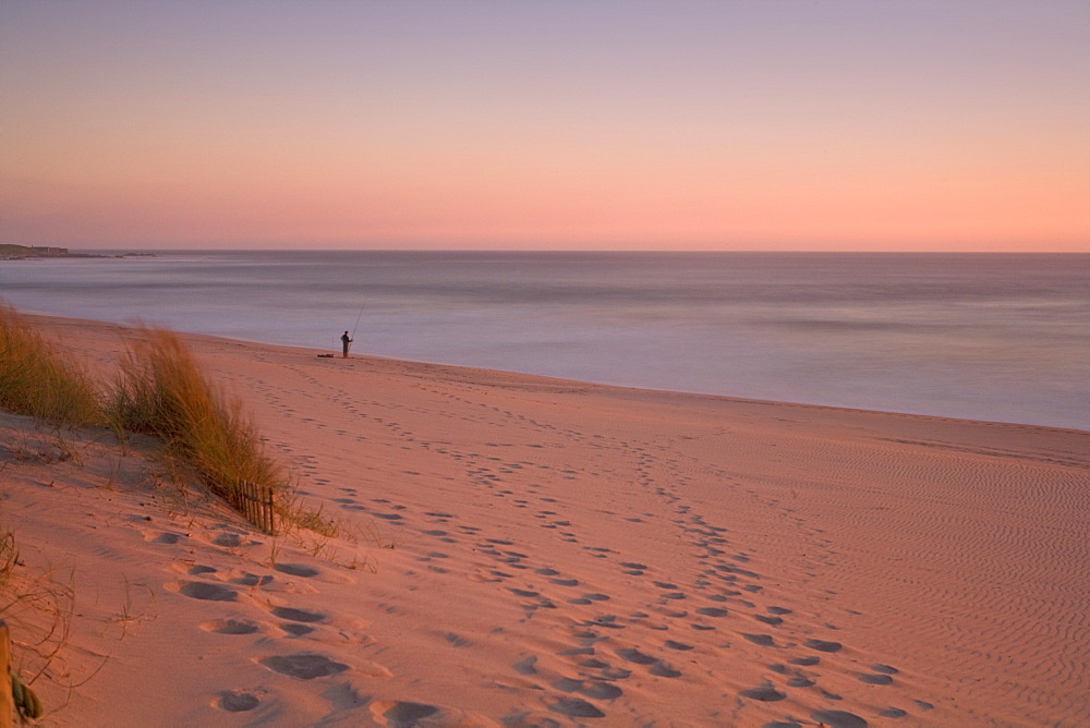 Lone fisherman on beach at sunset, Portugal, Europe - 791-29