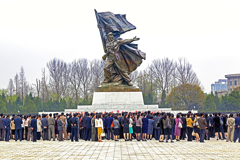 People coming to pay respects at the Monument to the Victorious Fatherland Liberation war, Pyongyang, Democratic People's Republic of Korea (DPRK), North Korea, Asia