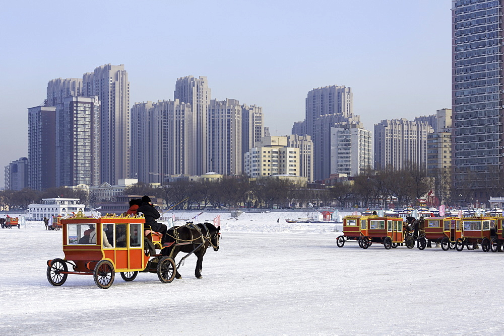 A carriage on the icebound Songhua River in Harbin, Heilongjiang, China, Asia - 794-4281