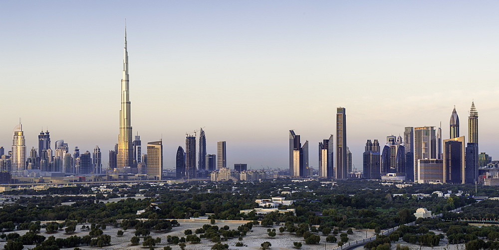 Elevated view of the new Dubai skyline, the Burj Khalifa, modern architecture and skyscrapers on Sheikh Zayed Road, Dubai, United Arab Emirates, Middle East
