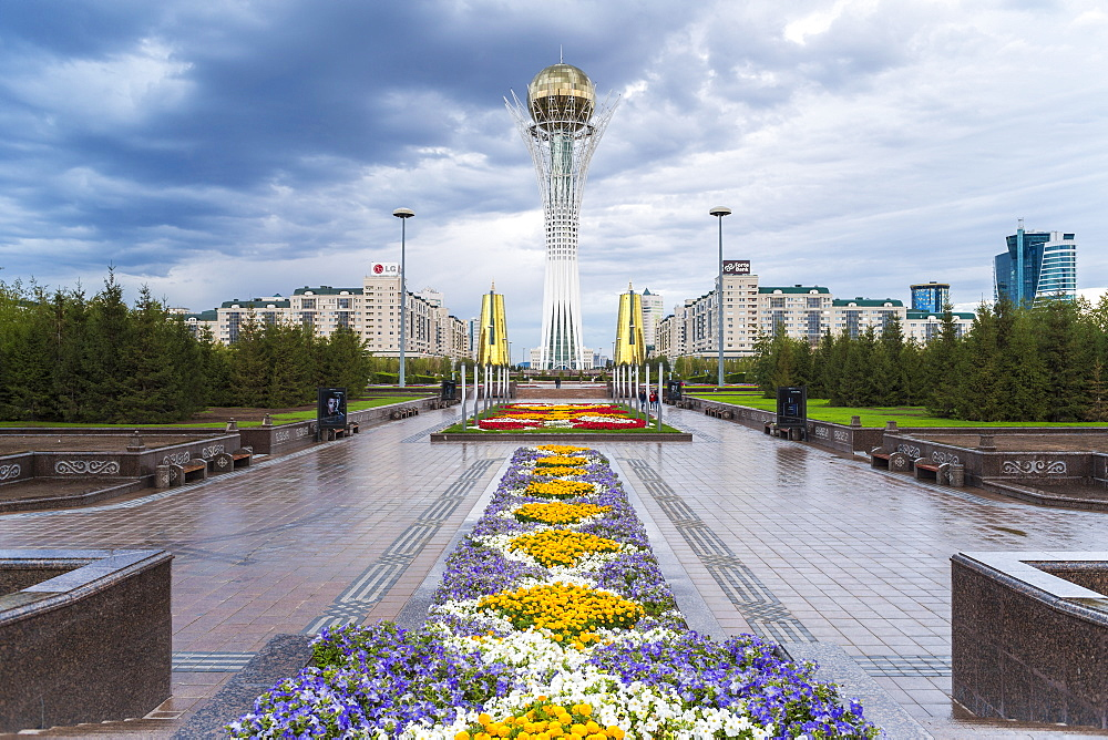 Nurzhol Bulvar, Central Boulevard and Bayterek Tower illuminated at night, Astana, Kazakhstan, Central Asia