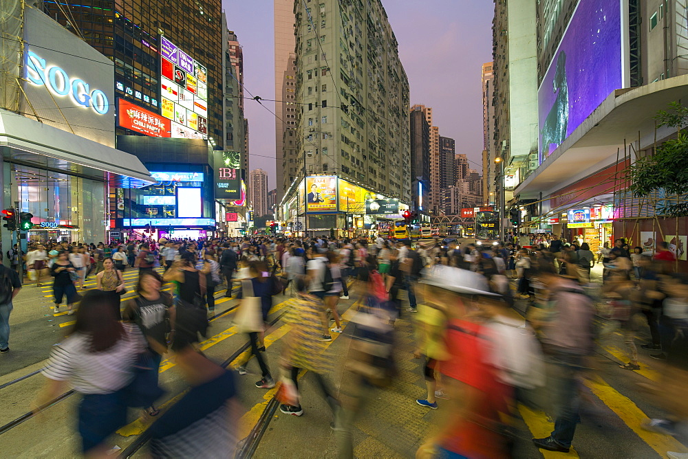 Pedestrians and traffic at a busy road crossing in Causeway Bay, Hong Kong Island, Hong Kong, China, Asia