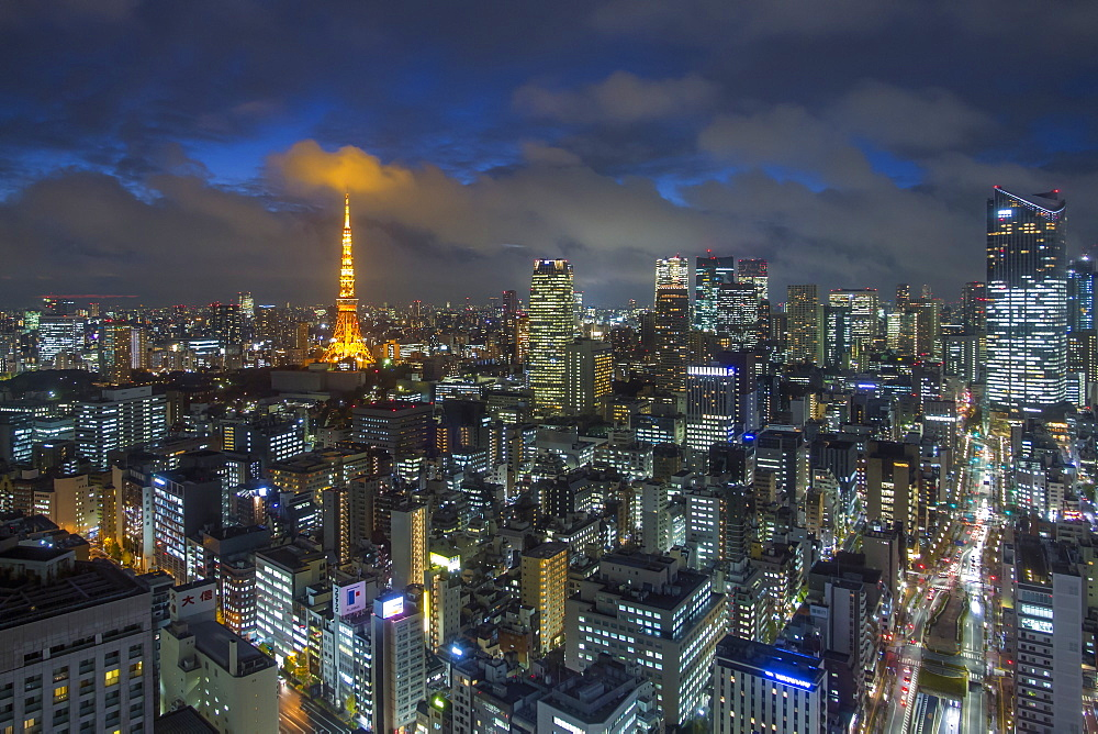 Japan, Tokyo, elevated night view of the city skyline and iconic illuminated Tokyo Tower - 794-4520