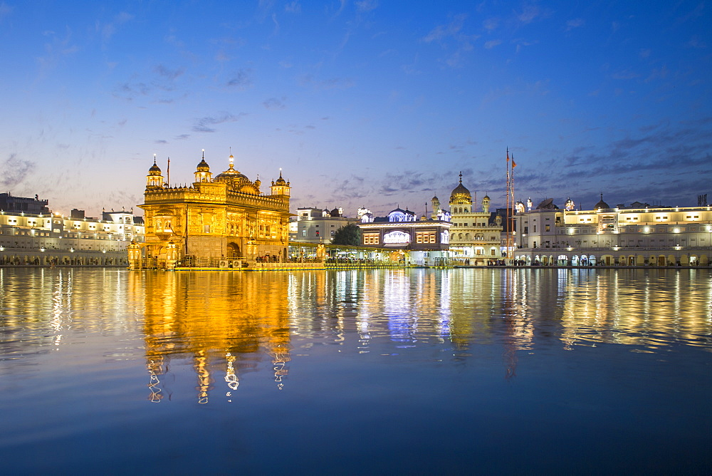The Golden Temple (Harmandir Sahib) and Amrit Sarovar (Pool of Nectar) (Lake of Nectar), illuminated at dusk, Amritsar, Punjab, India, Asia - 794-4582