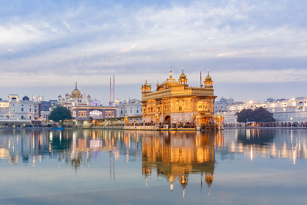 The Golden Temple (Harmandir Sahib) and Amrit Sarovar (Pool of Nectar) (Lake of Nectar), illuminated at dusk, Amritsar, Punjab, India, Asia - 794-4612
