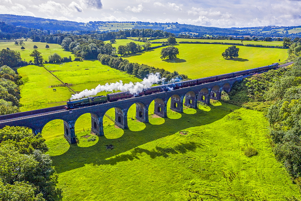 Steam locomotive crossing the Stanway Viaduct, Toddington, Gloucestershire, England, United Kingdom, Europe