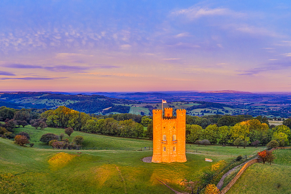 Broadway Tower on top of Fish Hill illuminated at sunrise, Broadway, Worcestershire, England, United Kingdom, Europe
