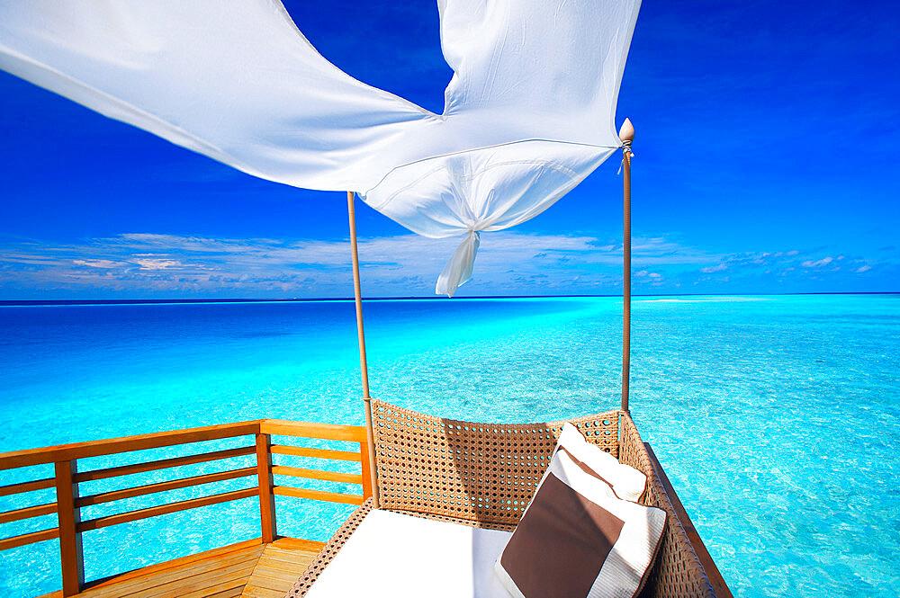 Sofa on tropical beach, Maldives, Indian Ocean, Asia