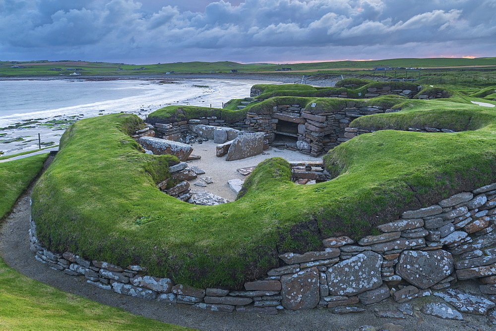 Stormy sky over Skara Brae, UNESSCO World Heritage Site, a Neolithic village on the Mainland of Orkney, Scotland, United Kingdom, Europe