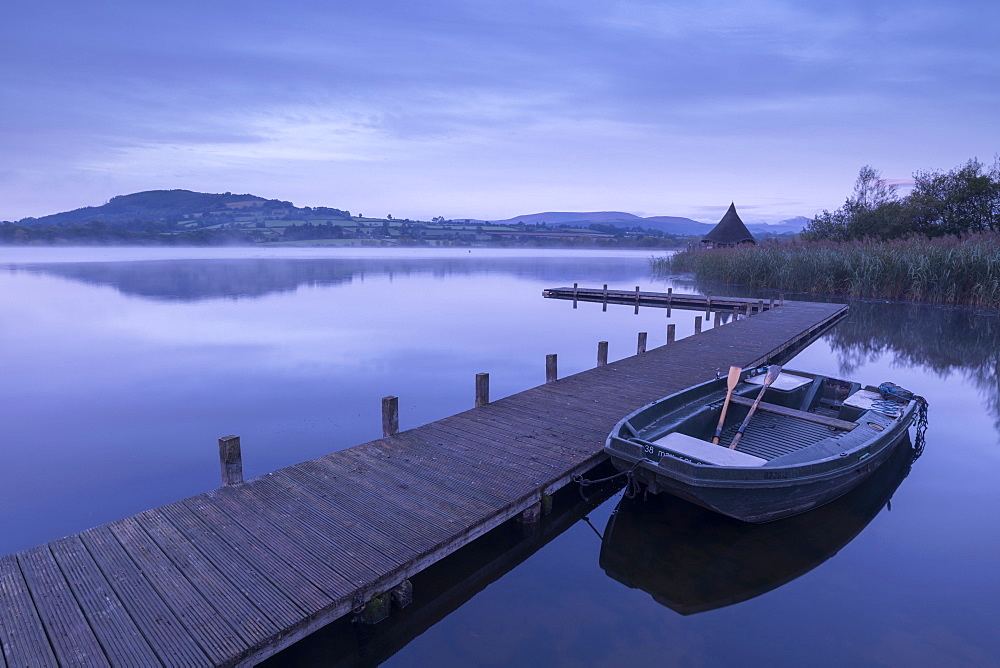 Moored boat on a wooden jetty on Llangorse Lake, Brecon Beacons, Powys, Wales, United Kingdom, Europe