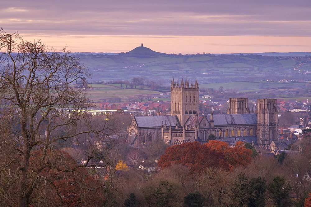 Wells Cathedral and Glastonbury Tor at dawn in winter, Wells, Somerset, England, United Kingdom, Europe