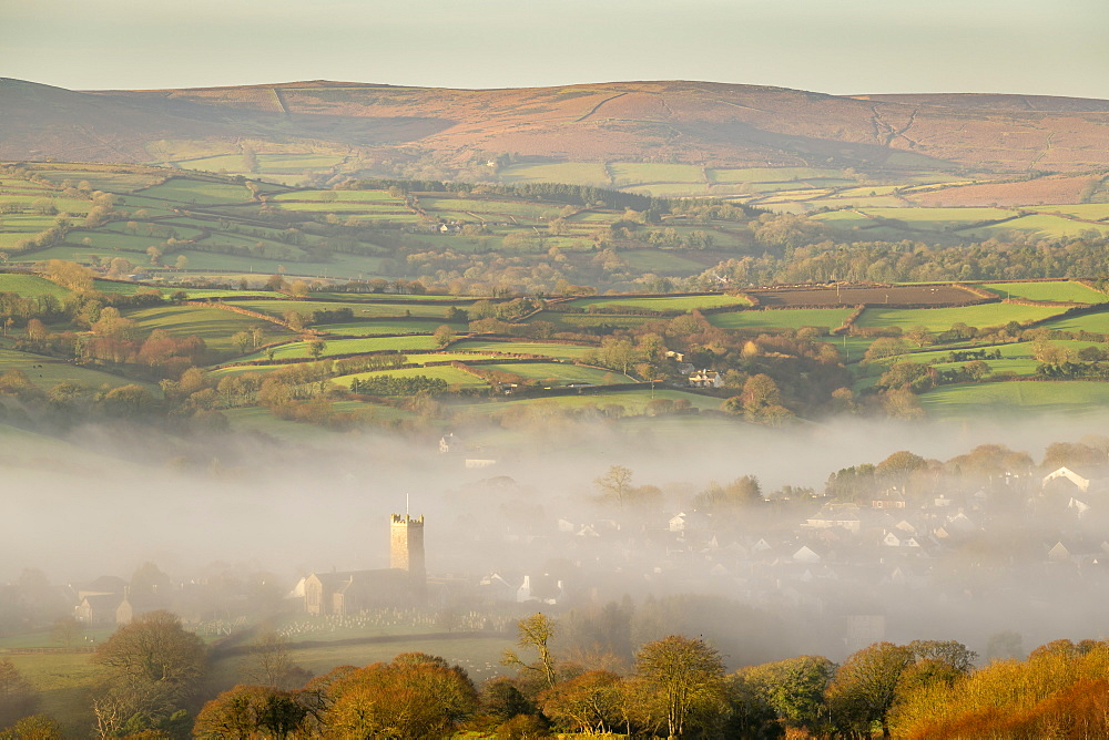 Misty winter morning view towards the church and Dartmoor village of Moretonhampstead, Devon, England, United Kingdom, Europe