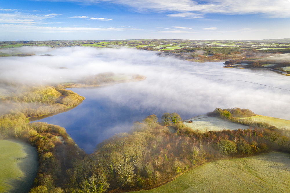 View by drone of morning mist in winter over Roadford Lake in Devon, England, United Kingdom, Europe