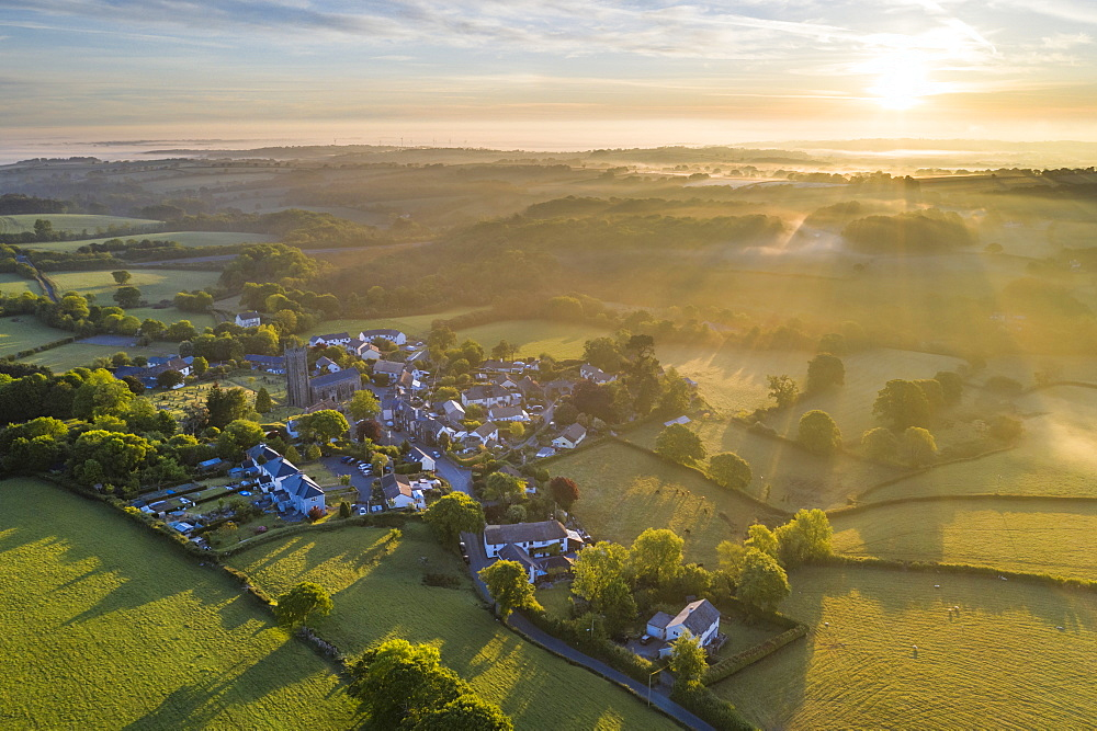 Sunrise over the Dartmoor village of South Tawton in Devon, England. Spring (May) 2020.