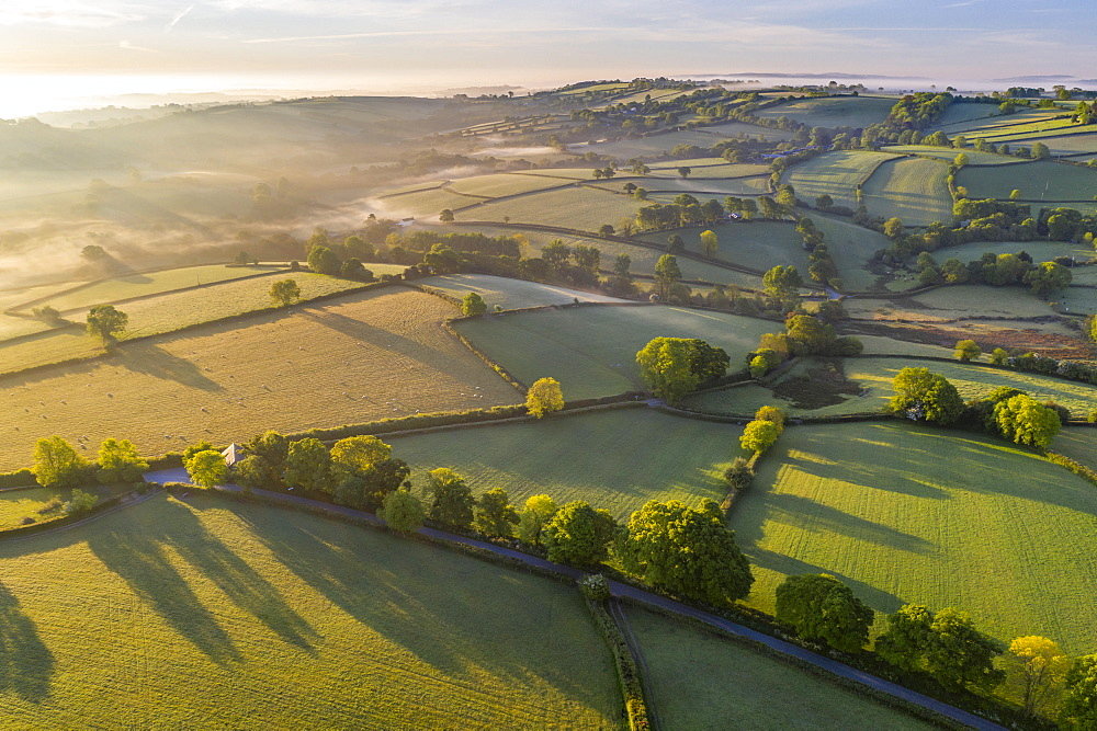 Beautiful morning sunlight over rolling countryside, South Tawton, Devon, England. Spring (May) 2020.