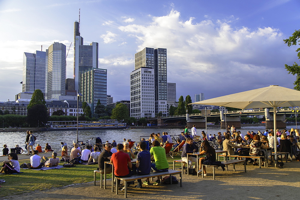 People sitting at outdoor bar beside River Main, Frankfurt, Hesse, Germany, Europe