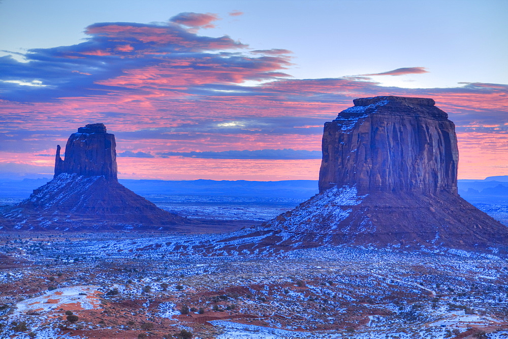 Sunrise, East Mitten Butte on left and Merrick Butte on right, Monument Valley Navajo Tribal Park, Utah, United States of America, North America