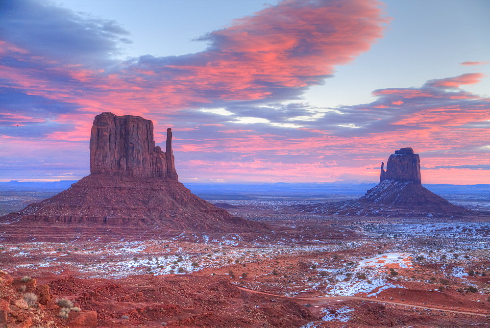 Sunrise, West Mitten Butte on left and East Mitten Butte on right, Monument Valley Navajo Tribal Park, Utah, United States of America, North America
