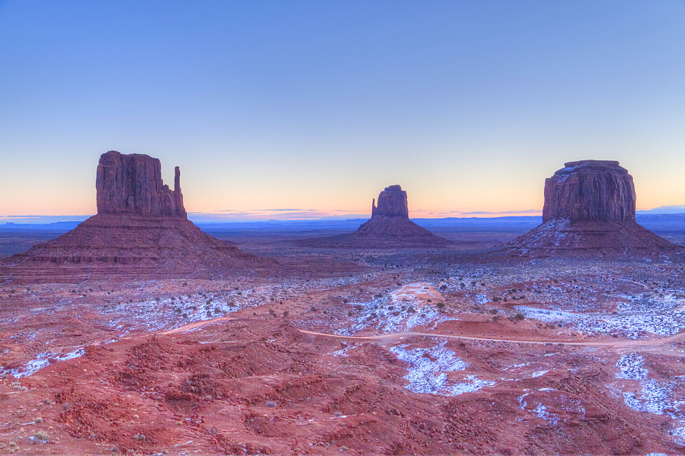 Sunrise, West (left) and East (center) Mitten Buttes, Merrick Butte (right), Monument Valley Navajo Tribal Park, Utah, USA - 801-1997