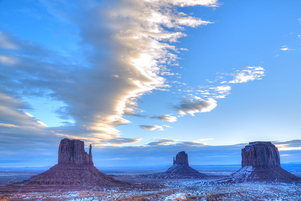 Sunrise, West (left) and East (center) Mitten Buttes, Merrick Butte (right), Monument Valley Navajo Tribal Park, Utah, USA