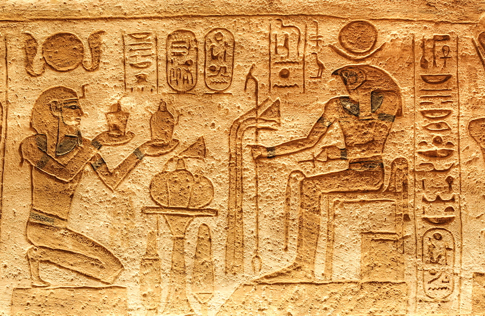 Ramses II on left with God Horus seated on right, Sunken Relief, Lateral Chamber, Ramses II Temple, UNESCO World Heritage Site, Abu Simbel, Nubia, Egypt, North Africa, Africa