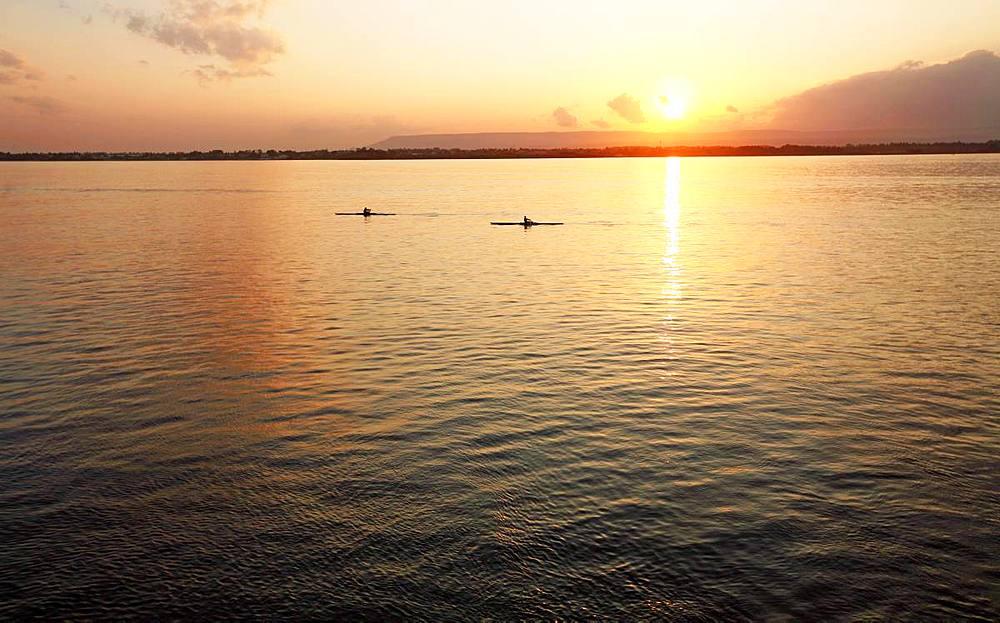 Canoeists at sunset, Ortigia, Sicily, Italy, Mediterranean, Europe - 802-468