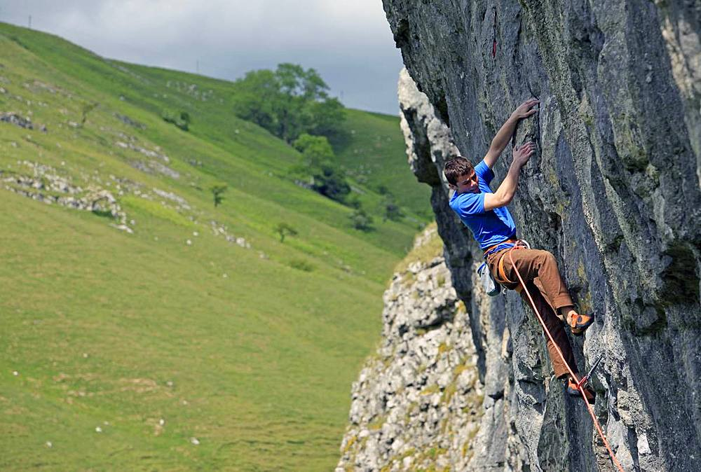 Rock climber in action, Yorkshire Dales National Park, North Yorkshire, England, United Kingdom, Europe - 802-480