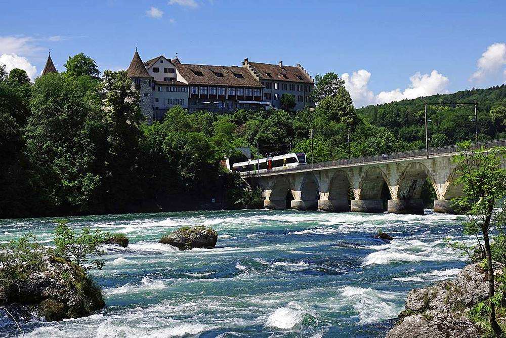 Rail bridge across the River Rhine at Rheinfall (Rhine Falls), near Schauffhausen, Switzerland, Europe