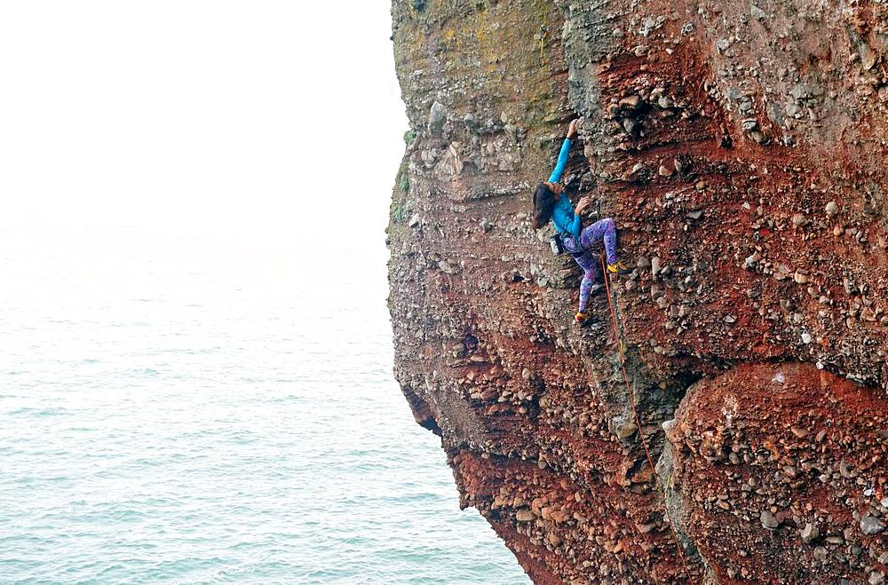 Rock climber in action, Watcombe Beach, South Devon, England, United Kingdom, Europe - 802-503