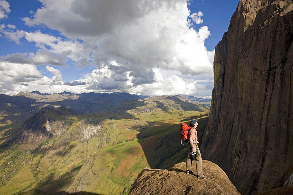 Climber looks across the Tsaranoro Massif, southern Madagascar, Africa - 802-547