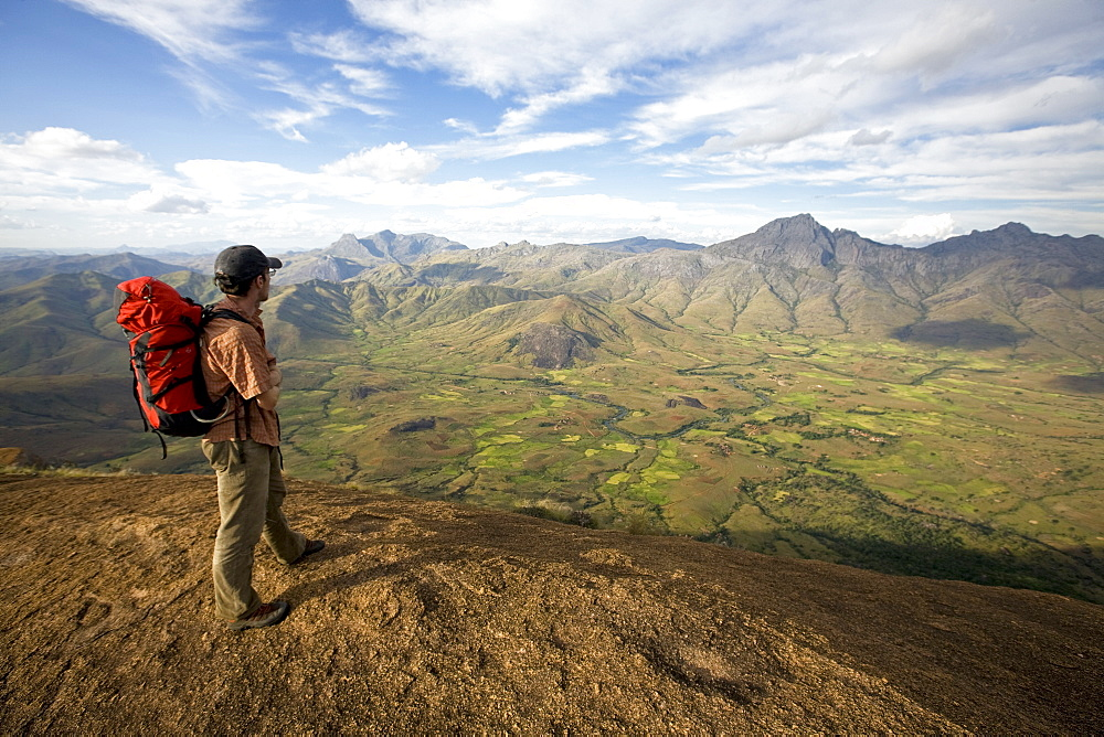 Climber looks across the Tsaranoro Massif, southern Madagascar, Africa - 802-551