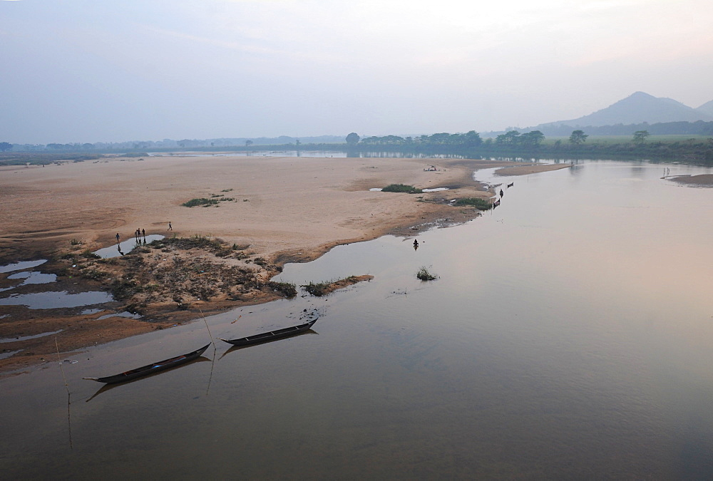 Morning light over river boats moored on the banks of the Mahanadi river, Cuttack district, Odisha, India, Asia