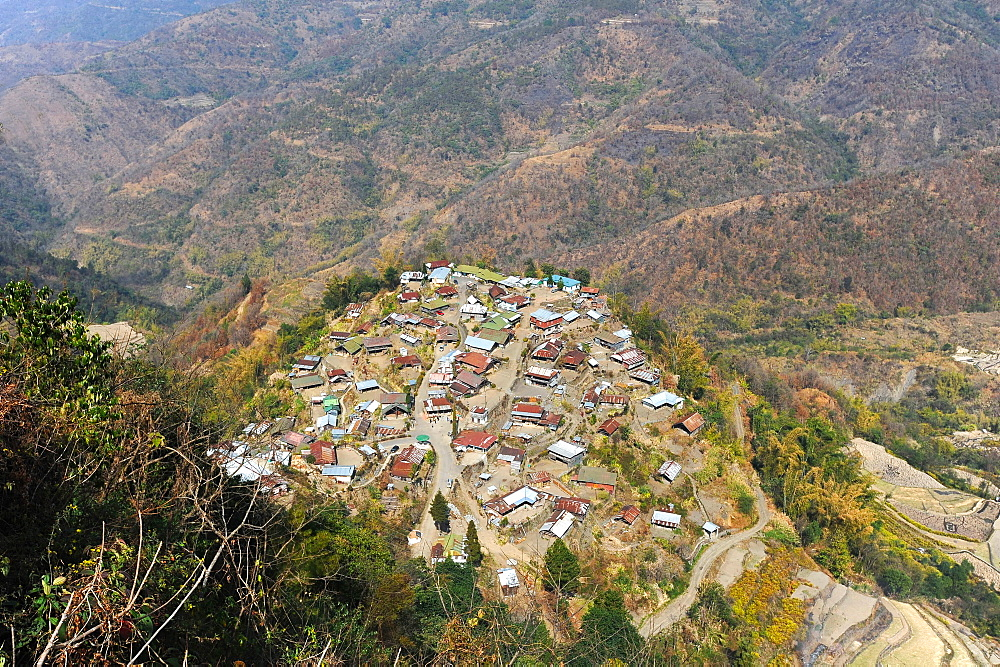 View across the slopes of the Naga hills and small Naga village, Phek district, Nagaland, India, Asia