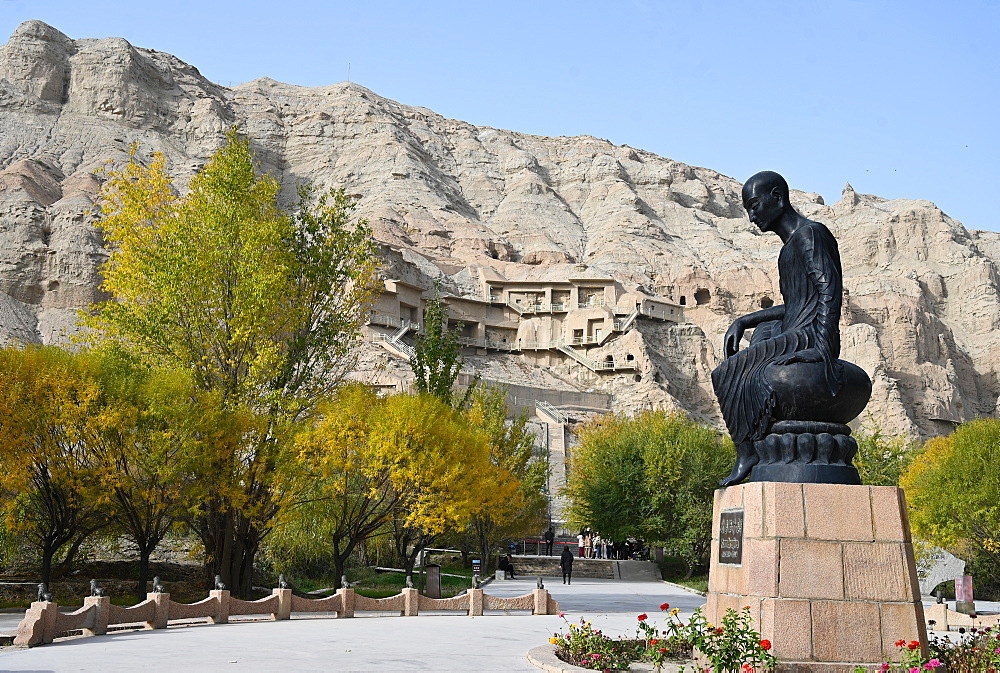 Statue of Kumarajiva, 4th century Buddhist monk from Kuche, at Kizil Caves, Xinjiang, China, Asia