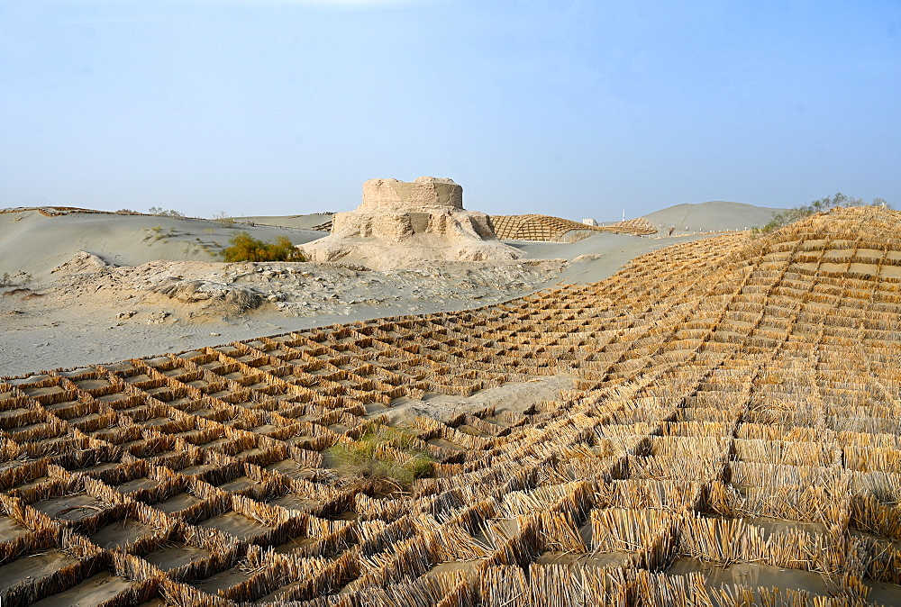 Straw sand control barriers around the 4th century Rawak Buddhist stupa, Hotan, Xinjiang, China, Asia