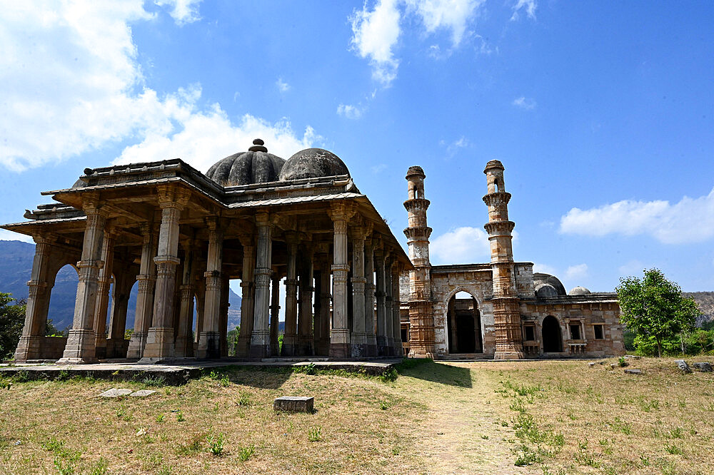View past pillared Kevada Masjid to Nagina Masjid, Jewel mosque, Champaner UNESCO Heritage park, Gujarat