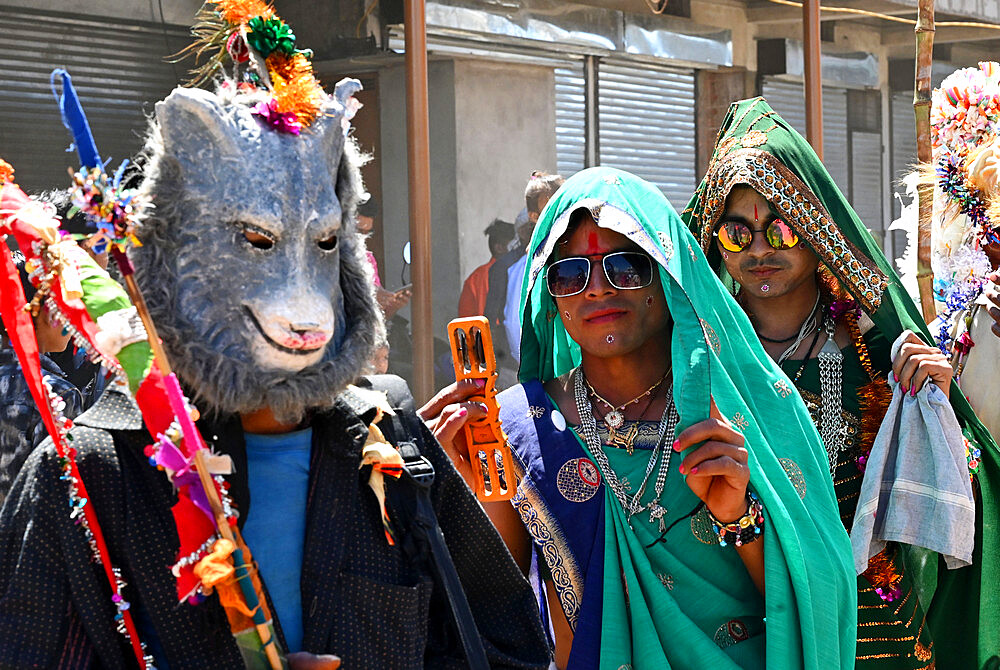 Adavasi tribal men dressed as women and animals to celebrate Holi festival, Kavant, Gujarat