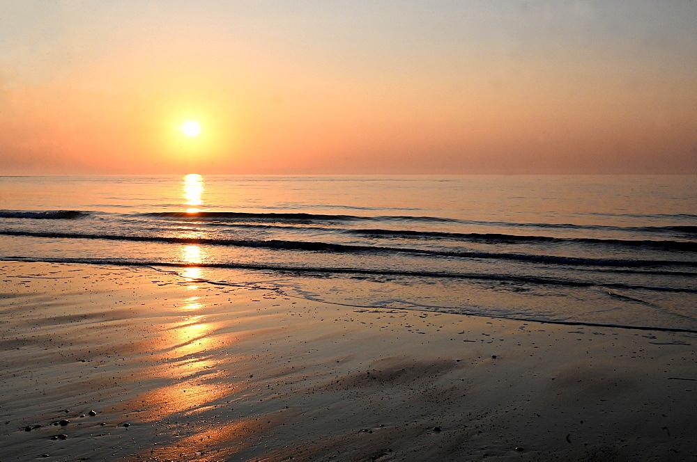 Sunrise over calm sea on the east coast of England, Walberswick, Suffolk, England, United Kingdom, Europe - 805-1460