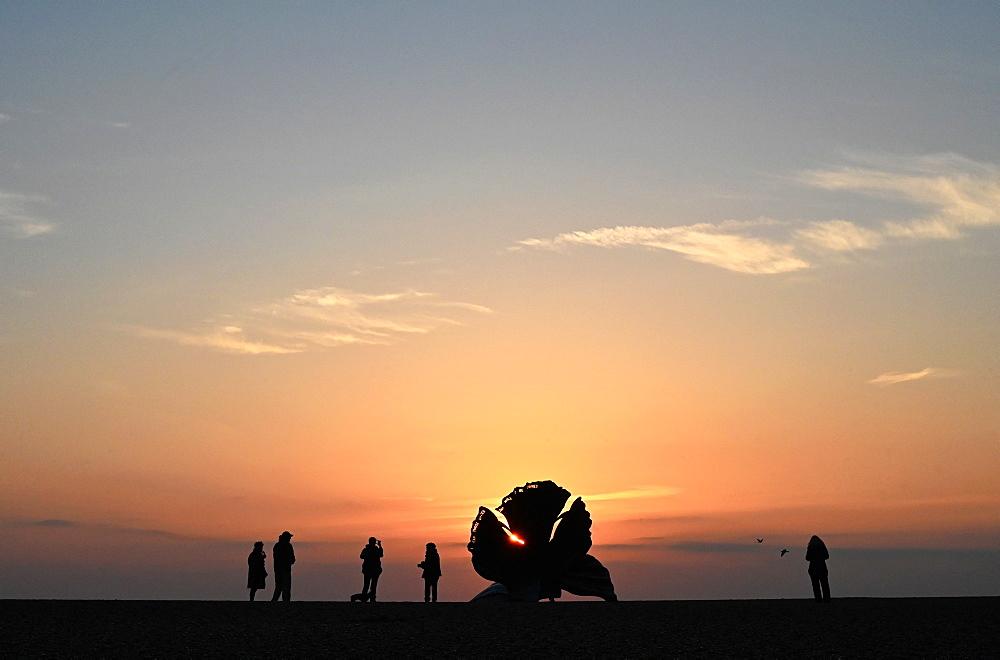 People watching sunrise beside The Scallop, sculpture by Maggi Hambling 2003, commemorating Benjamin Britten, Aldeburgh, Suffolk, England, United Kingdom, Europe - 805-1462