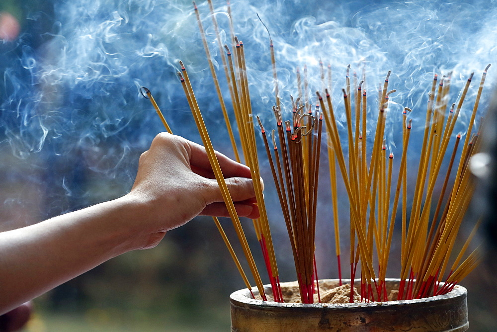Emperor Jade pagoda (Chua Phuoc Hai), incense sticks on joss stick pot burning, smoke used to pay respect to the Buddha, Ho Chi Minh City, Vietnam, Indochina, Southeast Asia, Asia