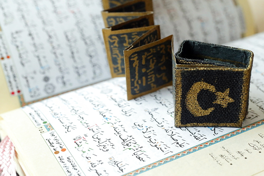 Close-up of Quran, crescent, star and surats, Muslim symbols, Vietnam, Indochina, Southeast Asia, Asia