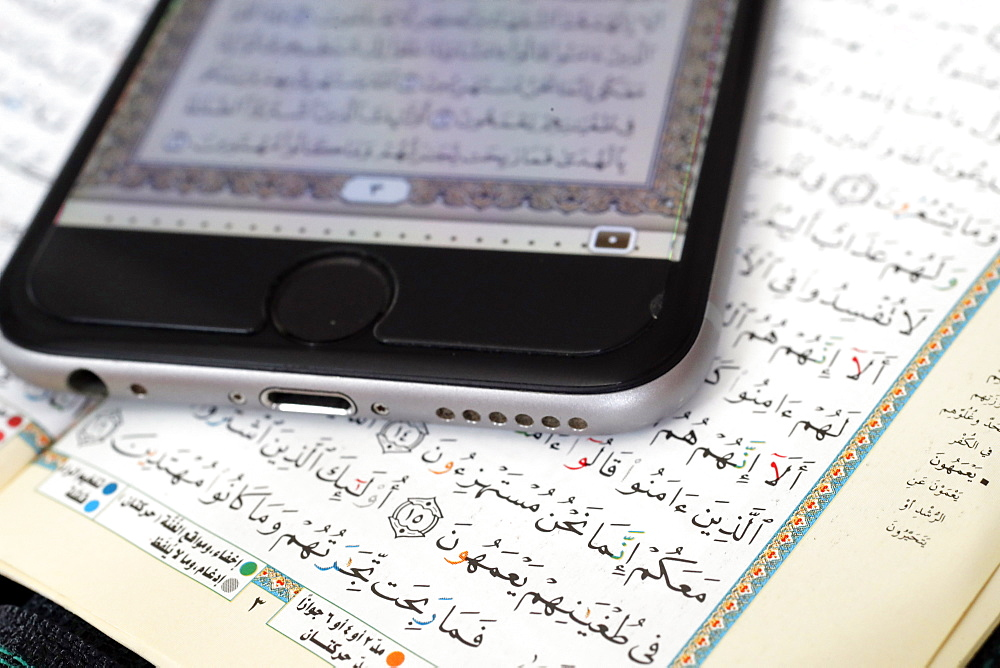 Digital Quran on a smartphone and Holy Quran book, Vietnam, Indochina, Southeast Asia, Asia