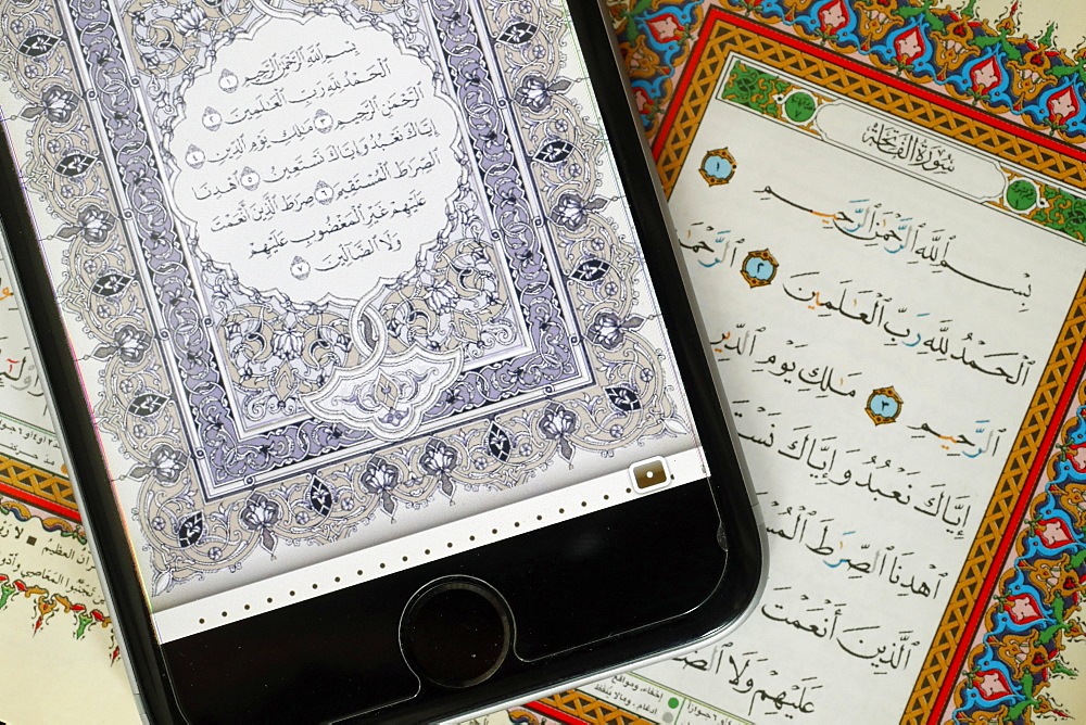 Digital Quran on a smartphone and Holy Quran book, Surat al-Fatiah, the first chapter, Vietnam, Indochina, Southeast Asia, Asia - 809-7695