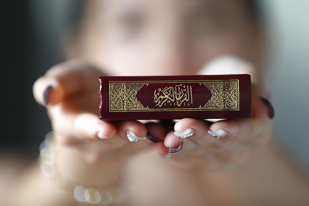 Muslim woman holding the Holy Quran book, Indochina, Southeast Asia, Asia - 809-7697