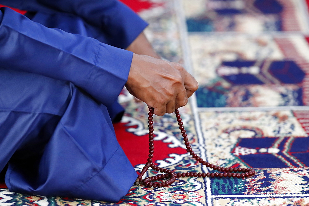 Muslim praying with Tasbih (prayer beads), Ho Chi Minh City, Vietnam, Indochina, Southeast Asia, Asia