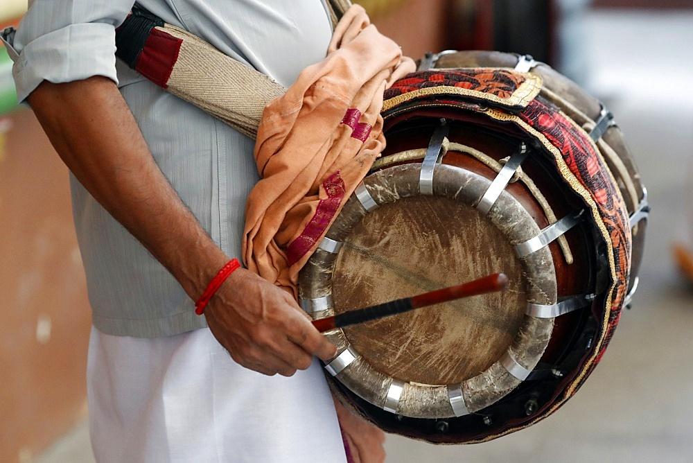 Musician playing a Thavil, a traditional Indian drum, Sri Mahamariamman Hindu Temple, Kuala Lumpur. Malaysia, Southeast Asia, Asia
